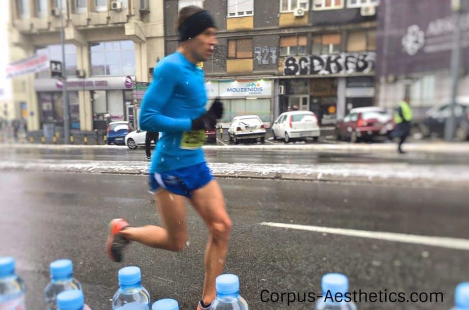 a man running on a winter marathon in Belgrade