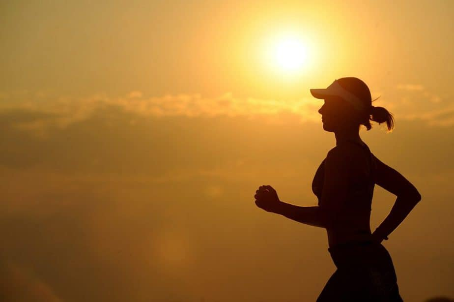 a woman jogging during sunset
