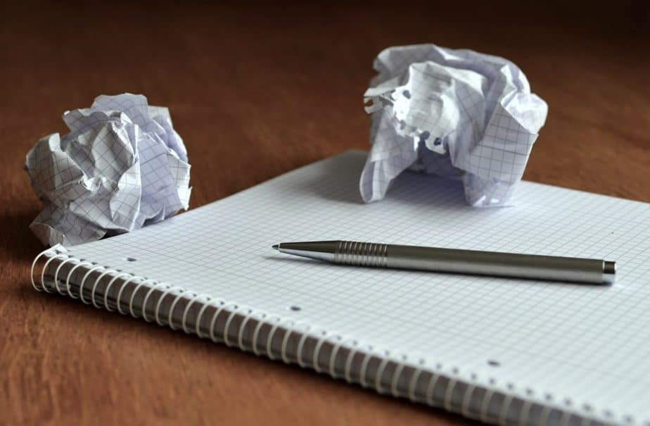 an empty notepad and a pen