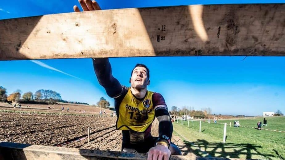 obstacle course race man running