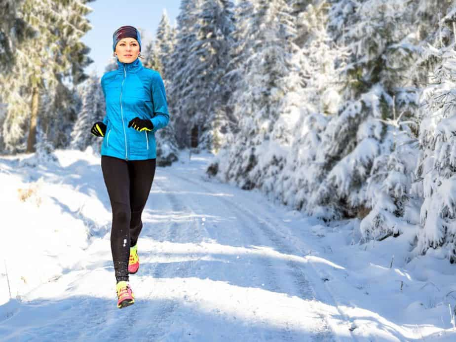 woman jogging outdoors during winter