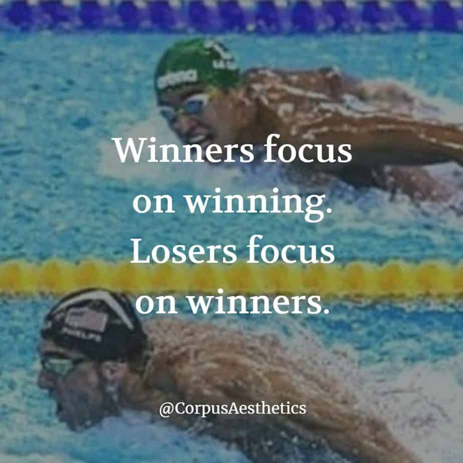fitness inspirational quote. winners focus on winning losers focus on winners. two swimmers competing in a swimming pool