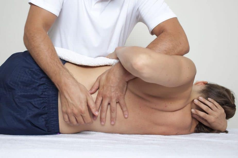 A chiropractor is treating a patient with a lower back pain