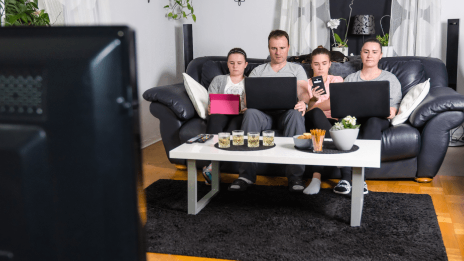 A modern family members with their devices, and it's sedentary lifestyle