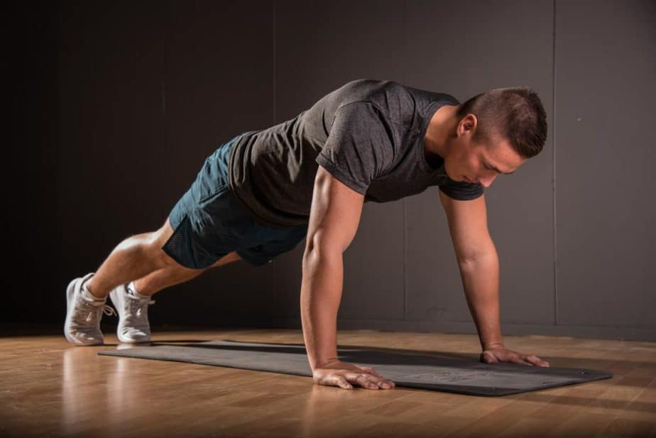 A guy has a training at home with push-ups