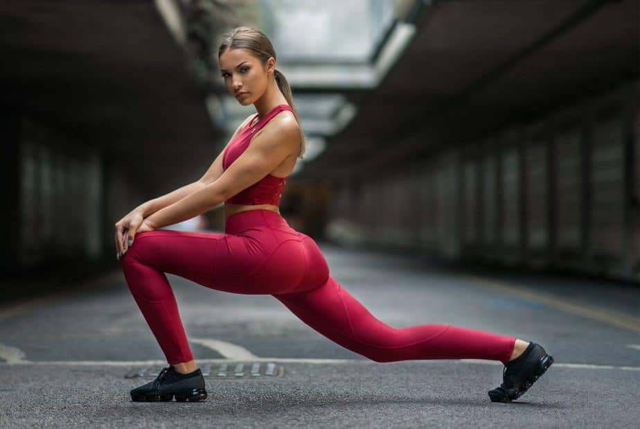A girl is stretching in flexibility wear