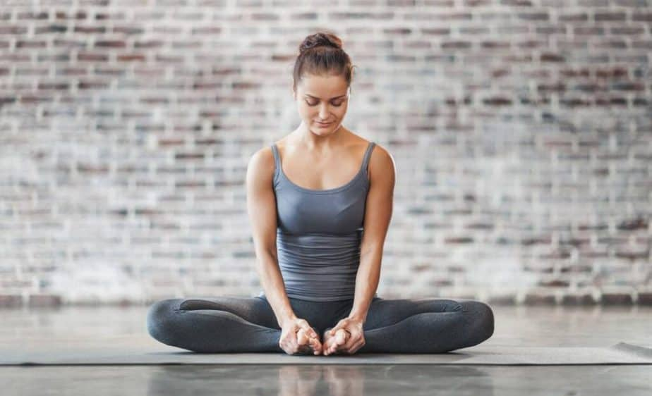 A girl is meditating at home