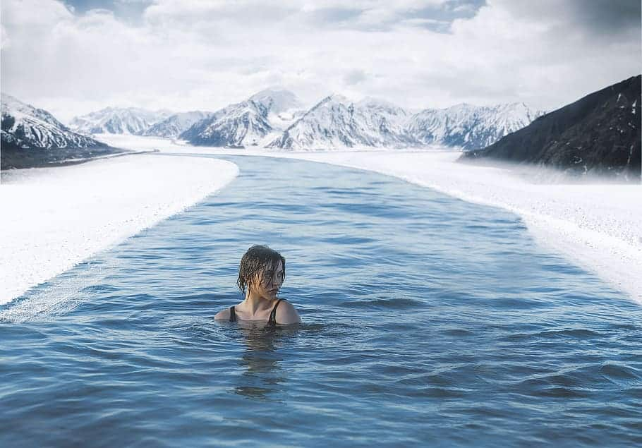 a girl bathing out in the cold during winter