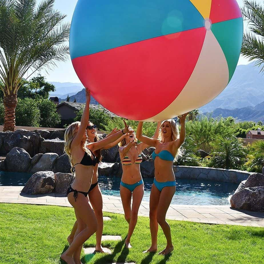 A group of girls are relaxing with playing ball