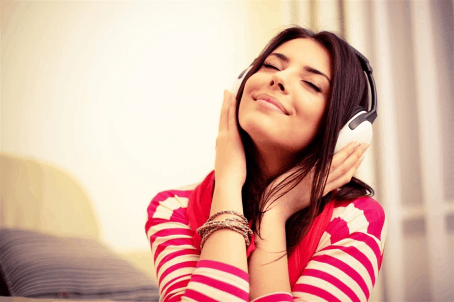 A girl is listening her favorite music at home
