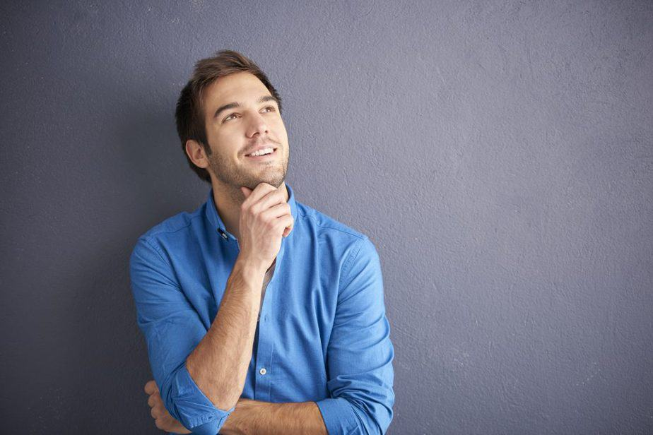 A guy is thinking about something (or someone) nice and beautiful