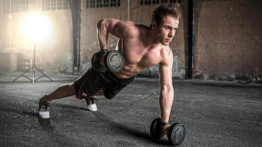 weightlifting workout - a guy pumping iron