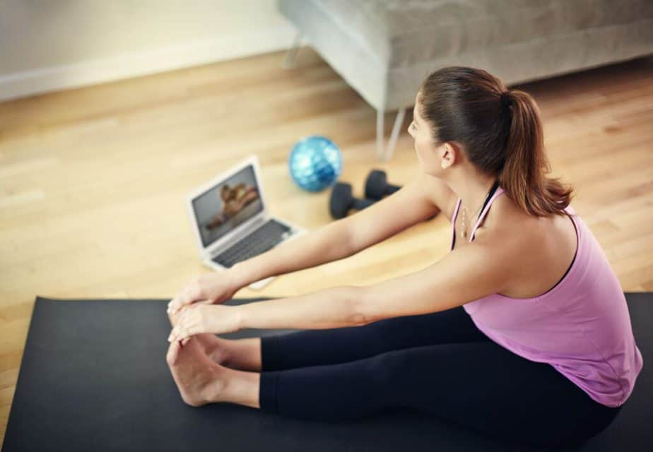A girl has an online training at home