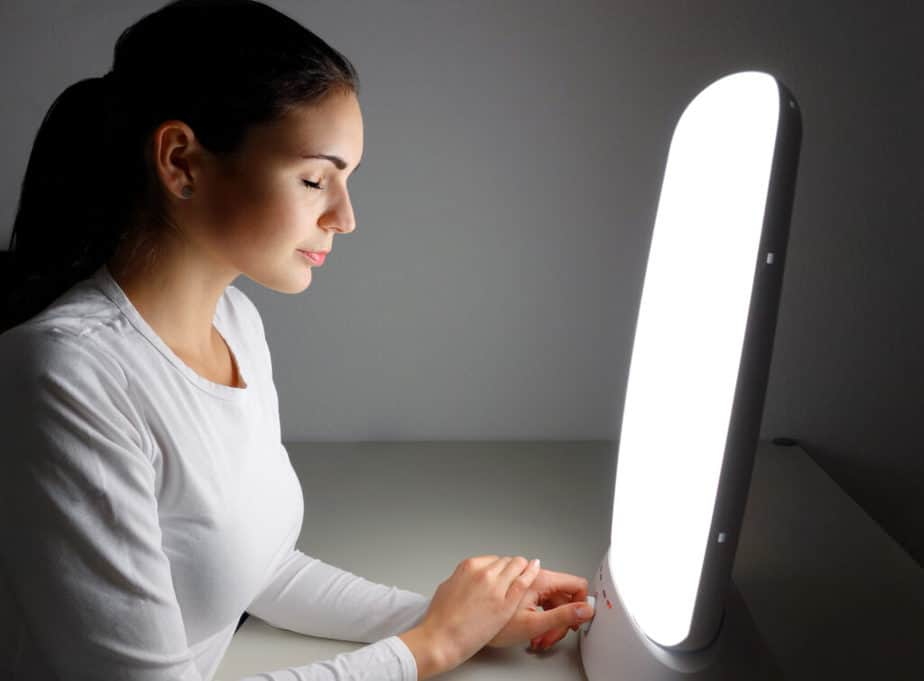 A girl on the light therapy