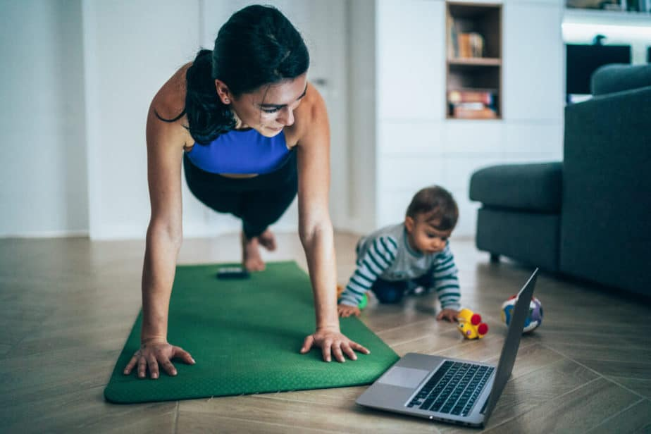 A young mother has an online training at home