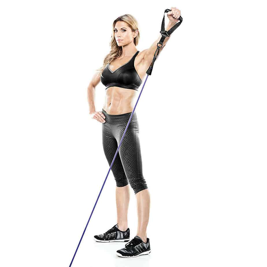 A girl is preparing for training with resistance tubes