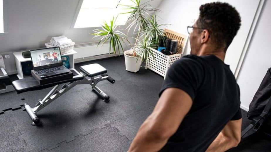A guy has an online training at home