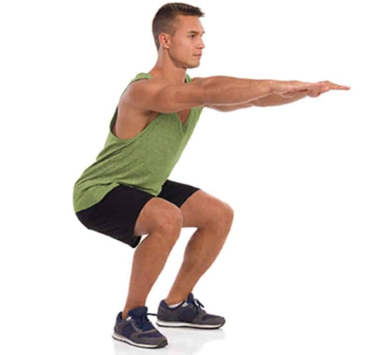 a man doing squats with arms straight