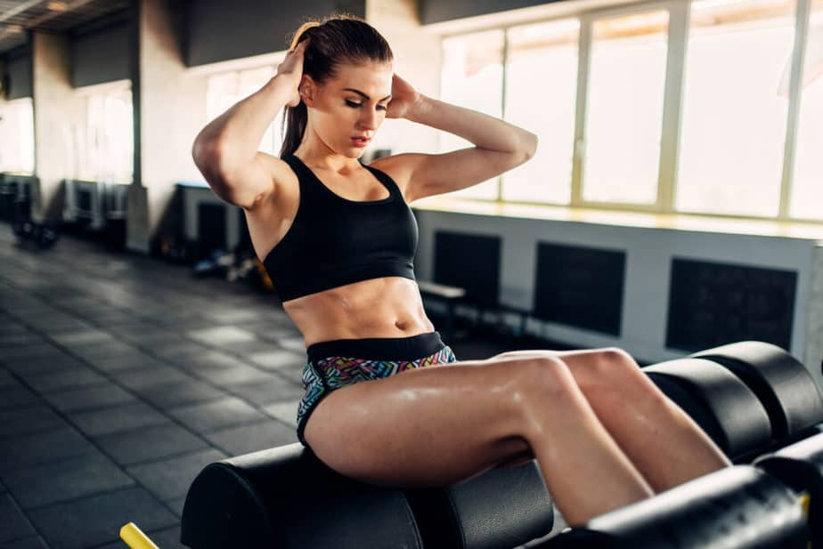 A girl is having training at the gym