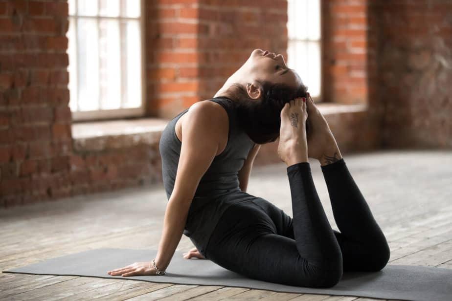 A girl is practicing yoga doing Bhujangasana pose