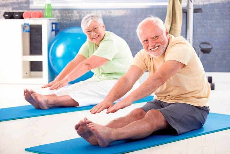 Elder couple has a training for back in the gym