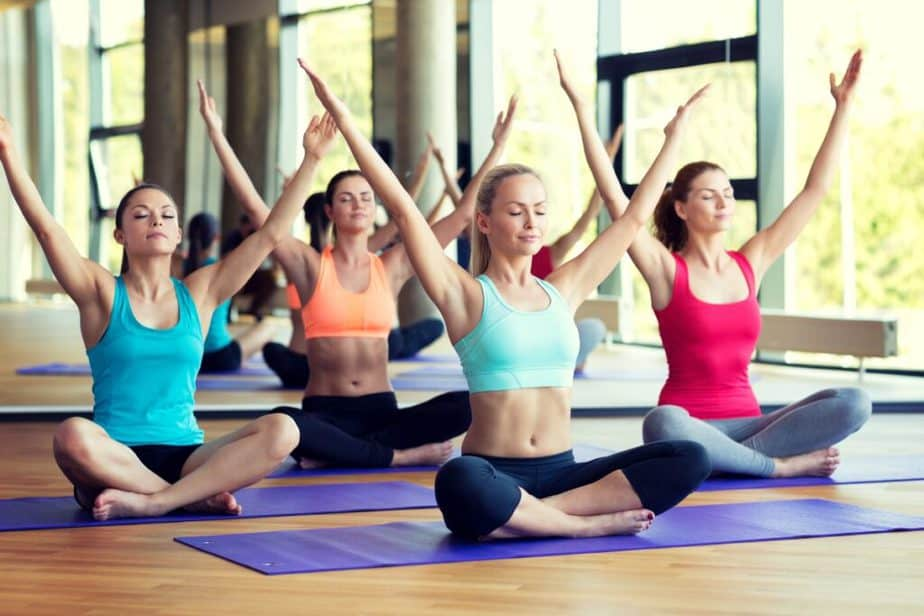 A group of girls are doing yoga