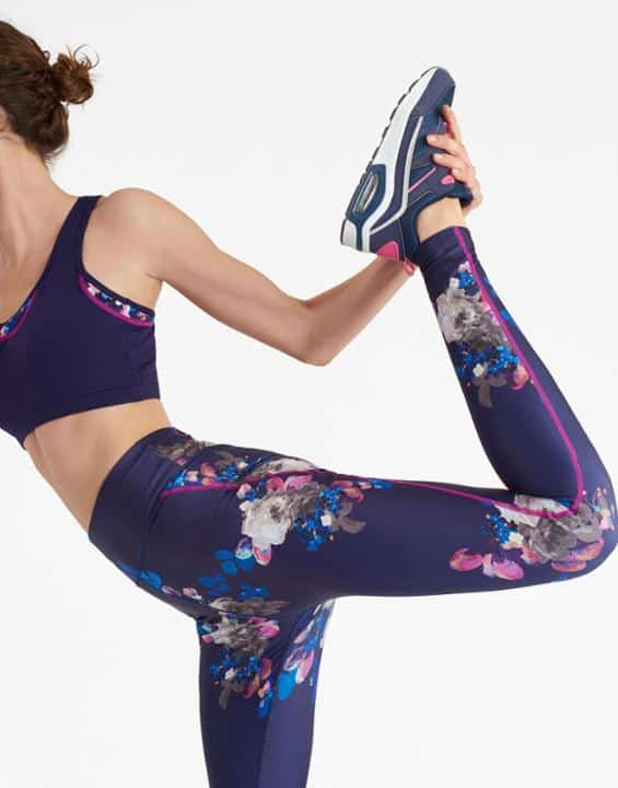 A girl is stretching in comfort sportswear
