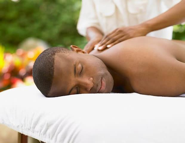 A young man has massage treatment