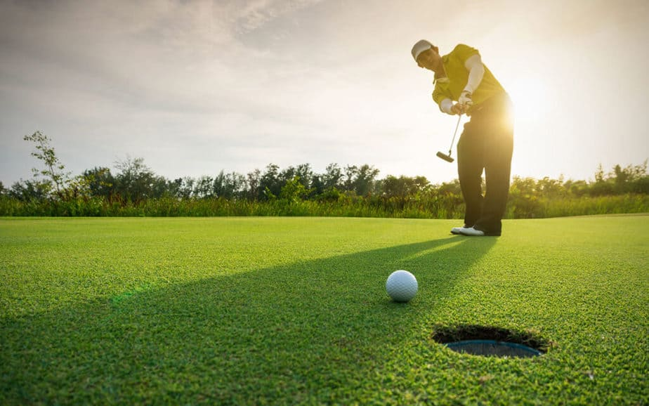 A young golfer is playing golf successfully
