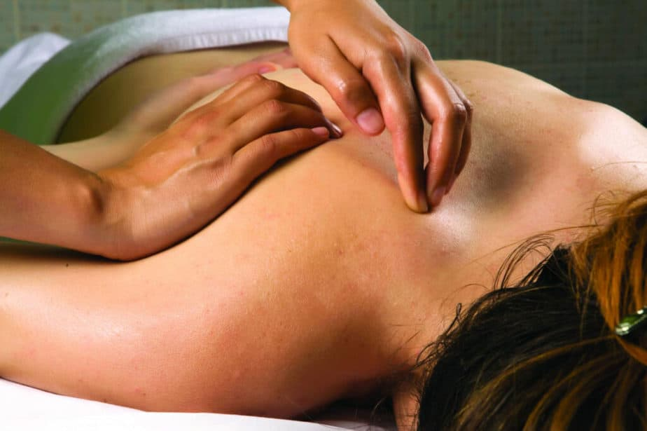 A woman has a shiatsu massage treatment