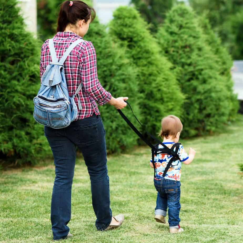 A young mom is walking with her child at the park