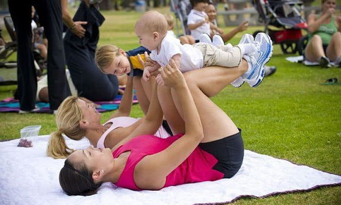 A group of young moms are practicing with their babies