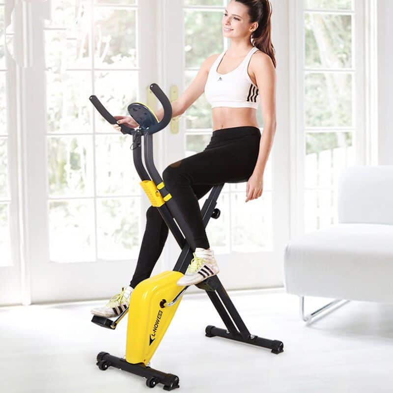 A girl on an exercise bike at home