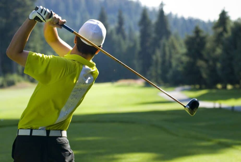 A young man is playing golf