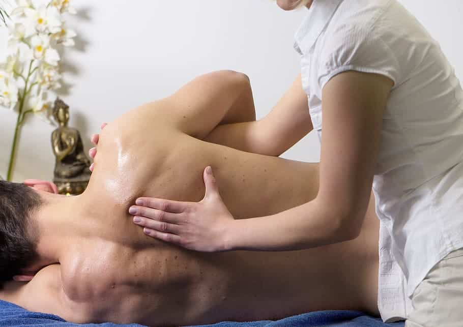 a man getting a shoulder massage at a spa