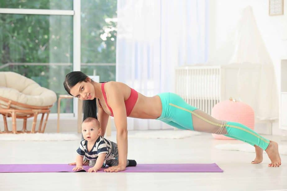 A mom has a training with her baby at home