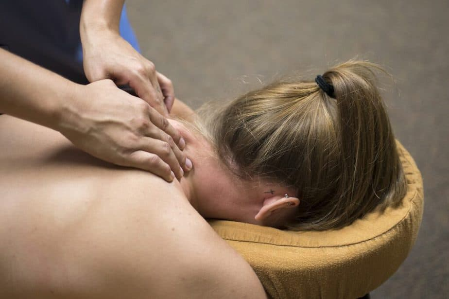 A young woman getting a neck massage