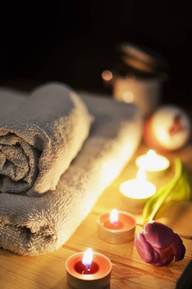 relaxing atmosphere at a spa with a massage table and tea lights