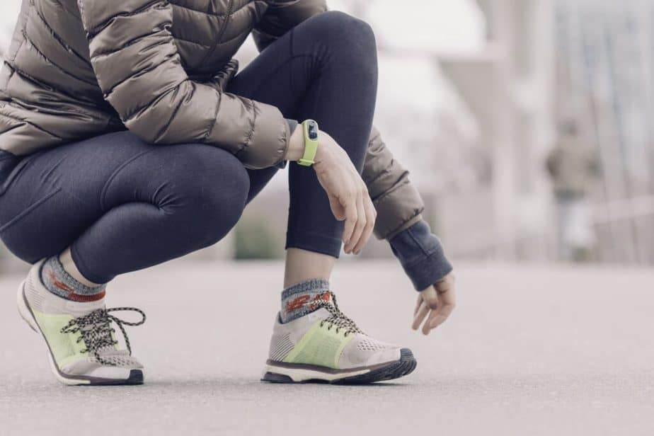 a jogger getting ready for a run with  a piece of wearable technology