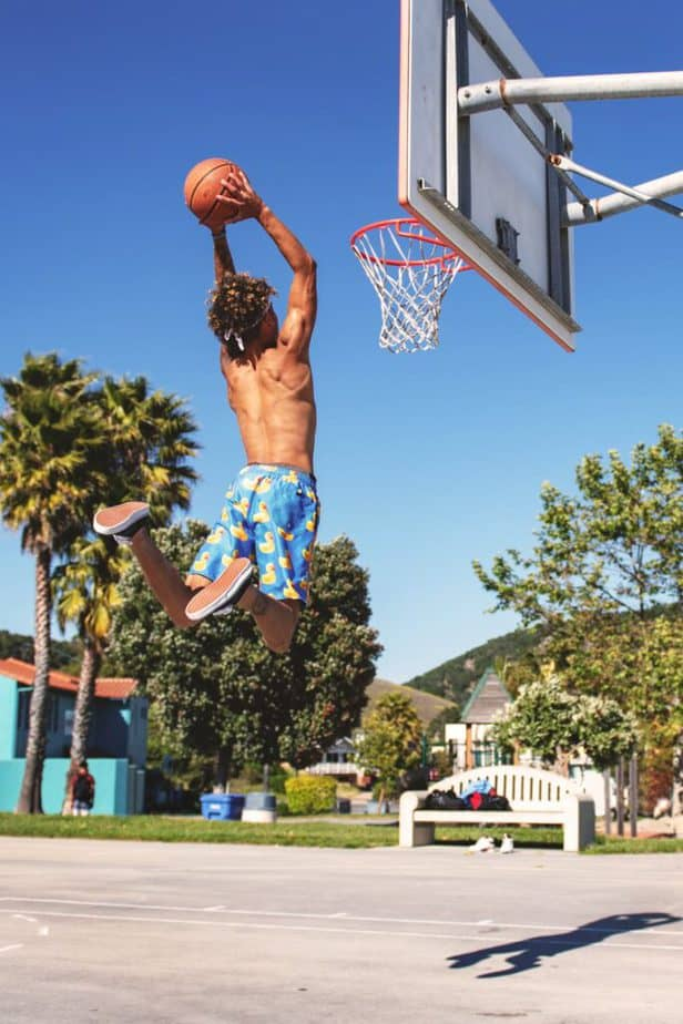 a guy playing basketball for his sports scolarship