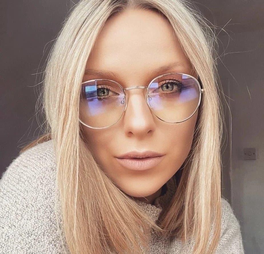 a girl wearing blue light glasses