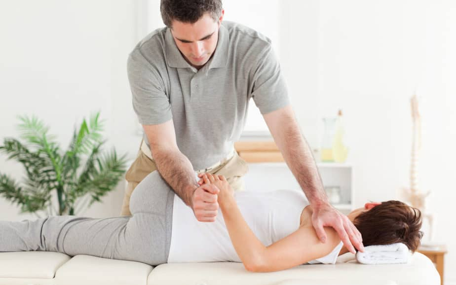 A chiropractor is treting his patient