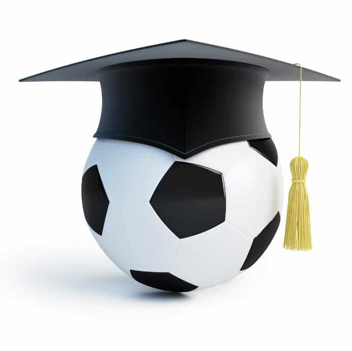 a football ball with a graduation hat