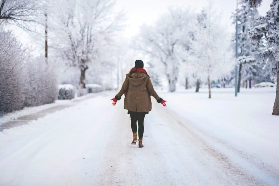 A girl is walking on snow