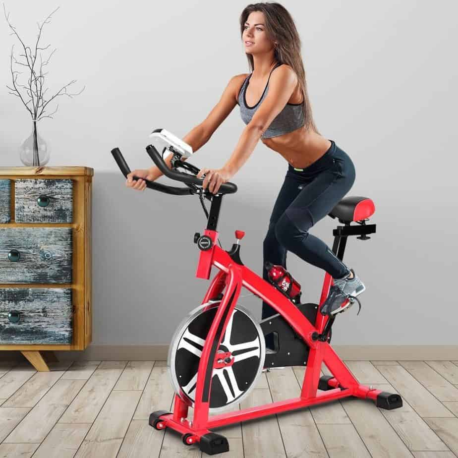 A girl on stationary bike at home
