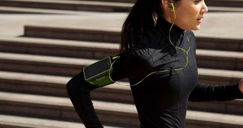 A girl is running while listening music on headphones