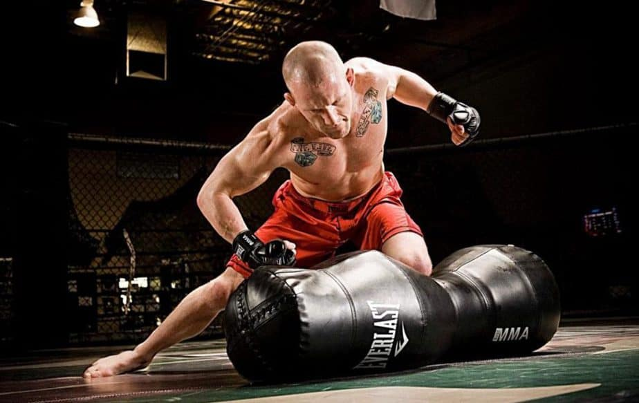 A guy has a training with punching bag
