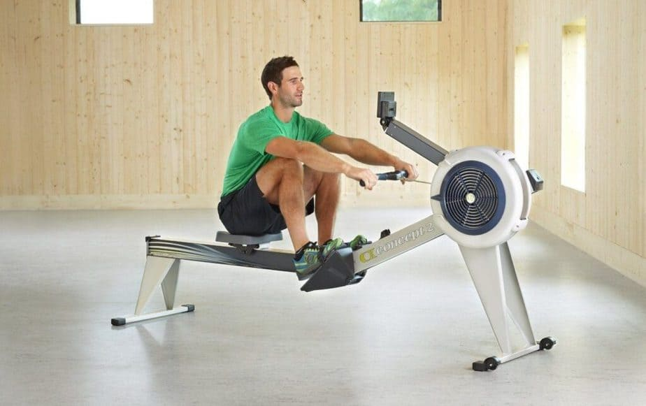 A guy has an exercise on rowing machine