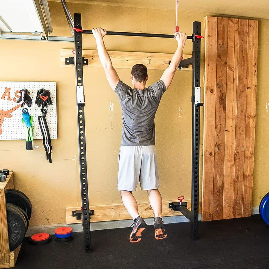 A guy is doing a pullups in his room