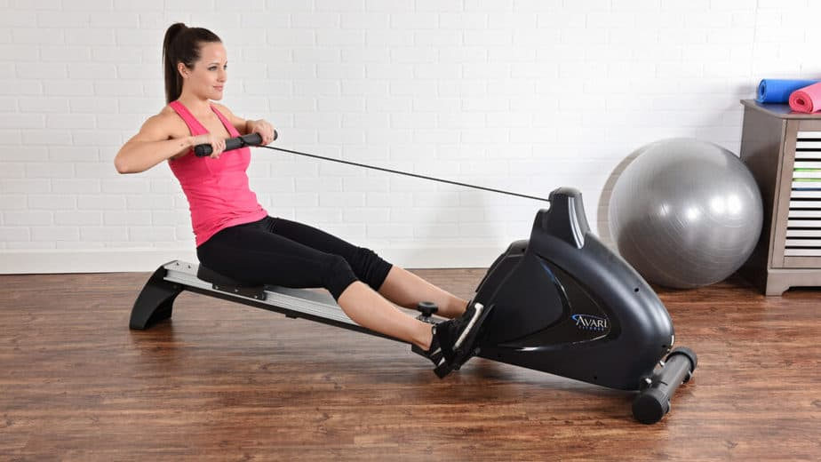 A girl has a weightloss training on rowing machine
